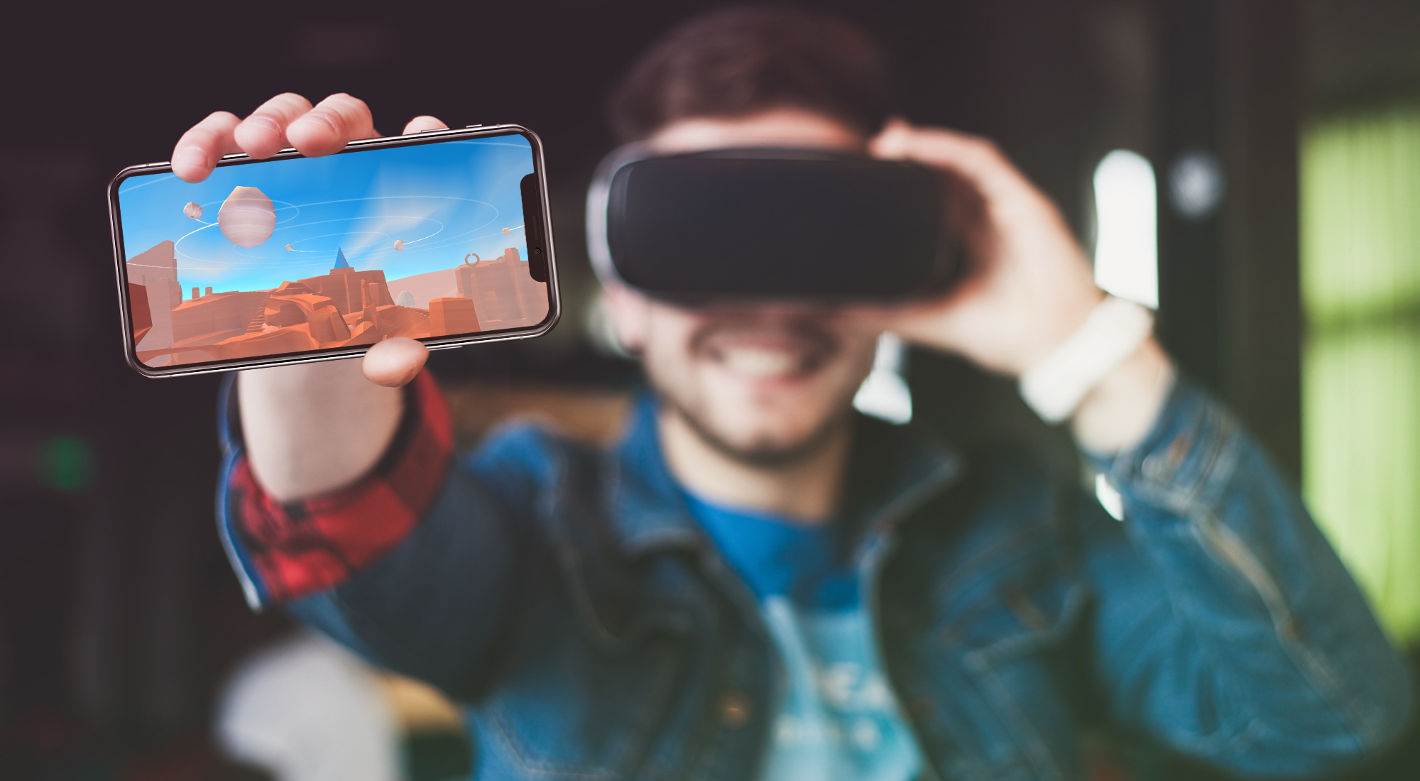 Man holding phone and VR headset