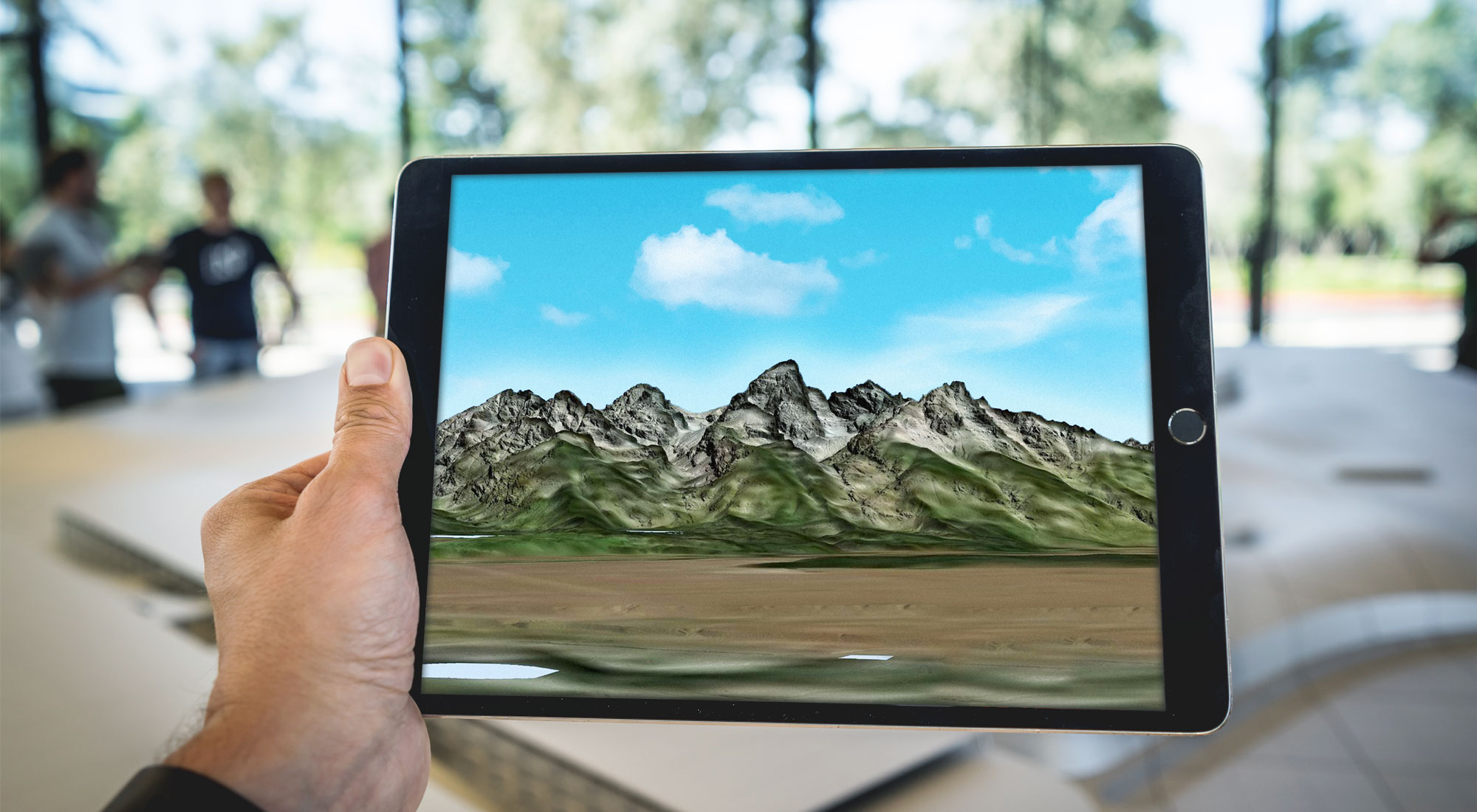iPad showing augmented reality mountains